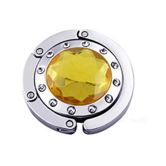 gul väskkrok eller väskhängare med stor strass kristall och små kristaller för att du ska kunna hänga din väska på bordet eller baren