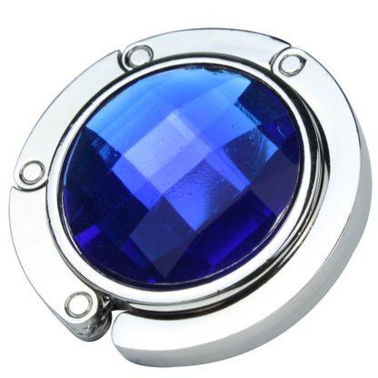 blå väskkrok eller väskhängare med stor strass kristall för att du ska kunna hänga din väska på bordet eller baren