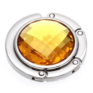 gul väskkrok eller väskhängare med stor strass kristall för att du ska kunna hänga din väska på bordet eller baren