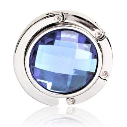 ljusblå väskkrok eller väskhängare med stor strass kristall för att du ska kunna hänga din väska på bordet eller baren