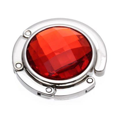 röd väskkrok eller väskhängare med stor strass kristall för att du ska kunna hänga din väska på bordet eller baren