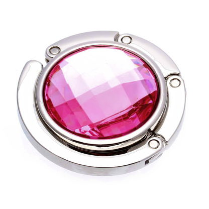 rosa väskkrok eller väskhängare med stor strass kristall för att du ska kunna hänga din väska på bordet eller baren