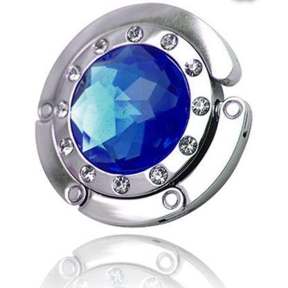 blå väskkrok eller väskhängare med stor strass kristall och små kristaller för att du ska kunna hänga din väska på bordet eller baren
