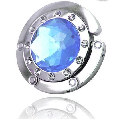 ljus blå väskkrok eller väskhängare med stor strass kristall och små kristaller för att du ska kunna hänga din väska på bordet eller baren