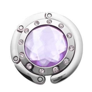 ljus lila väskkrok eller väskhängare med stor strass kristall och små kristaller för att du ska kunna hänga din väska på bordet eller baren