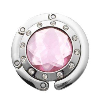 ljus rosa väskkrok eller väskhängare med stor strass kristall och små kristaller för att du ska kunna hänga din väska på bordet eller baren