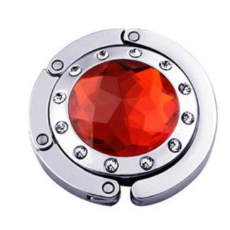 röd väskkrok eller väskhängare med stor strass kristall och små kristaller för att du ska kunna hänga din väska på bordet eller baren