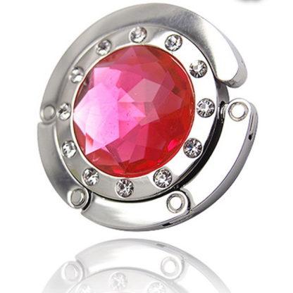 rosa väskkrok eller väskhängare med stor strass kristall och små kristaller för att du ska kunna hänga din väska på bordet eller baren