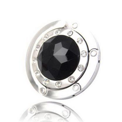 svart väskkrok eller väskhängare med stor strass kristall och små kristaller för att du ska kunna hänga din väska på bordet eller baren