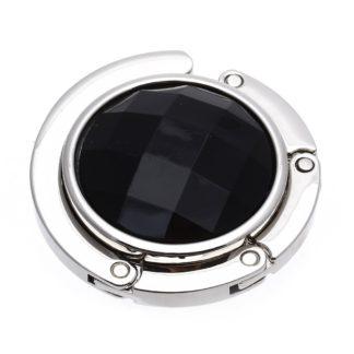 svart väskkrok eller väskhängare med stor strass kristall för att du ska kunna hänga din väska på bordet eller baren